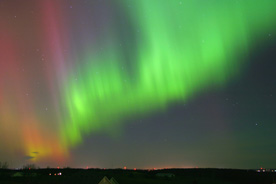 pink and green northern lights over Wisconsin