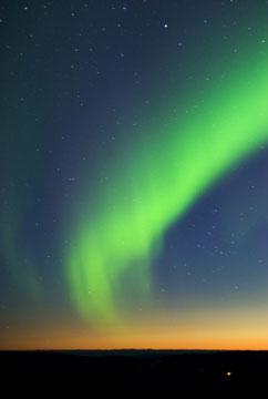 green northern lights at twilight